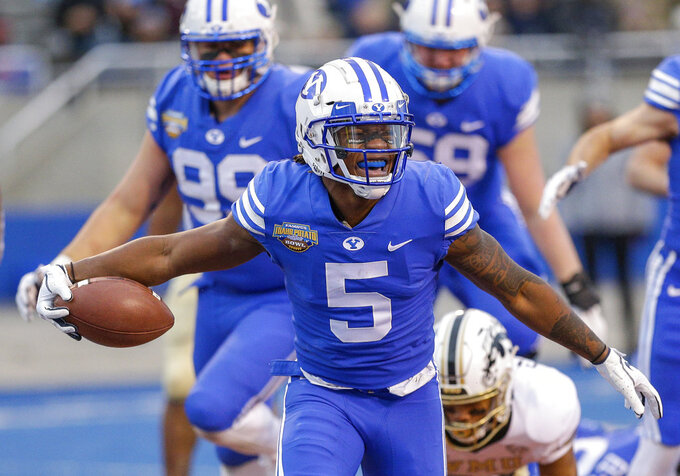 BYU defensive back Dayan Ghanwoloku (5) celebrates a 1-yard touchdown run against Western Michigan in the second half of the Famous Idaho Potato Bowl NCAA college football game, Friday, Dec. 21, 2018, in Boise, Idaho. (AP Photo/Steve Conner)