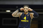 Marquette's Theo John (4) looks at the scoreboard after Marquette missed a shot during overtime of an NCAA college basketball game against Butler, Friday, Jan. 24, 2020, in Indianapolis. Butler won 89-85. (AP Photo/Darron Cummings)