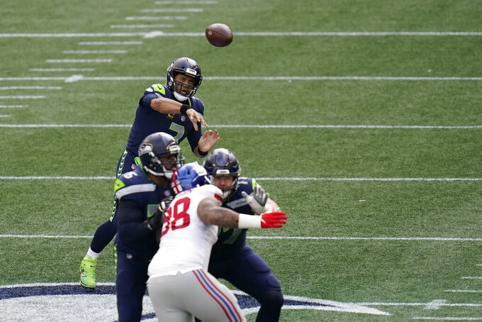 Seattle Seahawks quarterback Russell Wilson passes against the New York Giants during the first half of an NFL football game, Sunday, Dec. 6, 2020, in Seattle. (AP Photo/Elaine Thompson)