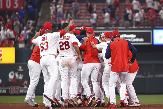 St. Louis Cardinals celebrate a 3-2 victory over the Chicago Cubs in a baseball game Wednesday, July 21, 2021, in St. Louis. (AP Photo/Joe Puetz)