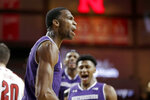 Northwestern's Vic Law, foreground, reacts after a basket and a foul against Nebraska during the second half of an NCAA college basketball game in Lincoln, Neb., Saturday, Feb. 16, 2019. (AP Photo/Nati Harnik)