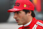 Ferrari's Spanish driver Carlos Sainz Jr reacts after taking the second position during the qualifying session of the 2021 Formula One Grand Prix of Russia at the Sochi Autodrom race track in Sochi, Russia, Saturday, Sept. 25, 2021. The Russian Formula One Grand Prix will be held on Sunday. (Yuri Kochetkov/Pool Photo via AP)