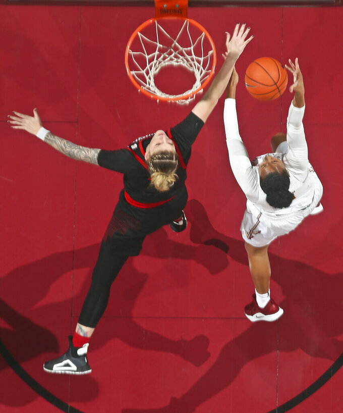 Louisville forward Sam Fuehring, left, can't stop Florida State guard Savannah Wilkinson from making a layup during the first half of an NCAA college basketball game in Tallahassee, Fla., Thursday, Jan. 24, 2019. (AP Photo/Phil Sears)