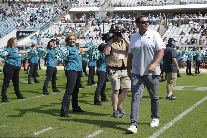 FILE - In this Oct. 13, 2019, file photo, former Jacksonville Jaguars player Tony Boselli is honored during a halftime ceremony  an NFL football game against the New Orleans Saints in Jacksonville, Fla. Boselli was selected as a finalist for the Pro Football Hall of Fame's class of 2021 on Tuesday, Jan. 5, 2021.  (AP Photo/Phelan M. Ebenhack, File)