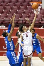Alabama guard Jaden Shackelford (5) gets by Kentucky forward Keion Brooks Jr (12) for a shot during the second half of an NCAA college basketball game, Tuesday, Jan. 26, 2021, in Tuscaloosa, Ala. (AP Photo/Vasha Hunt)