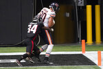 Chicago Bears tight end Jimmy Graham (80) scores a touchdown against Atlanta Falcons defensive back Darqueze Dennard (34) during the second half of an NFL football game, Sunday, Sept. 27, 2020, in Atlanta. (AP Photo/John Bazemore)