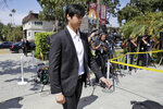 Los Angeles Angels player Shohei Ohtani arrives for a memorial for Angels pitcher Tyler Skaggs at the St. Monica Catholic Church Monday, July 22, 2019, in Los Angeles. (AP Photo/Marcio Jose Sanchez)