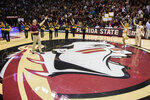 Florida State's new head football coach Mike Norvell is introduced at half time of an NCAA basketball game against Clemson in Tallahassee, Fla., Sunday, Dec. 8, 2019. (AP Photo/Mark Wallheiser)