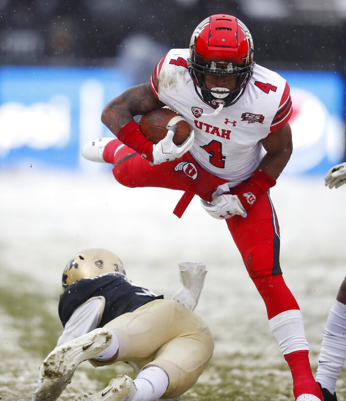 Utah running back TJ Green, right, avoids a tackle by Colorado defensive back Derrion Rakestraw in the second half of an NCAA college football game Saturday, Nov. 17, 2018, in Boulder, Colo. Utah won 30-7. (AP Photo/David Zalubowski)