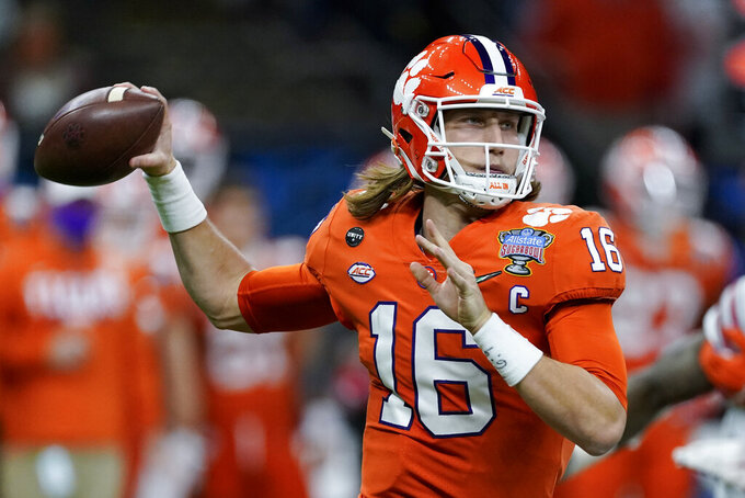 FILE - In this Friday, Jan. 1, 2021 file photo, Clemson quarterback Trevor Lawrence passes against Ohio State during the first half of the Sugar Bowl NCAA college football game in New Orleans. The last NFL event not impacted by the COVID-19 pandemic was the 2020 combine in Indianapolis. A year later, with the 2021 combine canceled, the league has released a list of players who would have merited invitations. From such high-profile quarterbacks as Clemson's Trevor Lawrence and Ohio State's Justin Fields to guys who sat out last season such as Oregon tackle Penei Sewell, there are 323 players from 100 schools.  (AP Photo/John Bazemore, File)