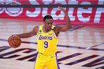 Los Angeles Lakers guard Rajon Rondo (9) signals to the offense during the second half an NBA conference final playoff basketball game against the Denver Nuggets on Friday, Sept. 18, 2020, in Lake Buena Vista, Fla. (AP Photo/Mark J. Terrill)