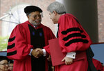 Historian Lonnie Bunch III, left, is presented with an honorary Doctor of Laws degree by Vice President and Secretary of Harvard University Marc Goodheart, right, during Harvard University commencement exercises, Thursday, May 30, 2019, on the school campus, in Cambridge, Mass. (AP Photo/Steven Senne)