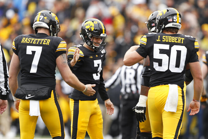 Iowa kicker Keith Duncan (3) celebrates with teammates Colten Rastetter, left, and Jackson Subbert, right, after kicking a 42-yard field goal during the first half of an NCAA college football game against Purdue, Saturday, Oct. 19, 2019, in Iowa City, Iowa. (AP Photo/Charlie Neibergall)