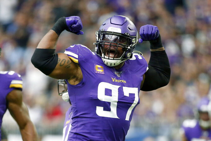 FILE - In this Sept. 22, 2019, file photo, Minnesota Vikings defensive end Everson Griffen (97) celebrates after a sack during the first half of an NFL football game against the Oakland Raiders in Minneapolis. Minnesota's four-time Pro Bowl pick has 74 1/2 career sacks, including 26 1/2 the past three seasons, but he exercised his option to void the remaining three years on his contract. (AP Photo/Bruce Kluckhohn, File)