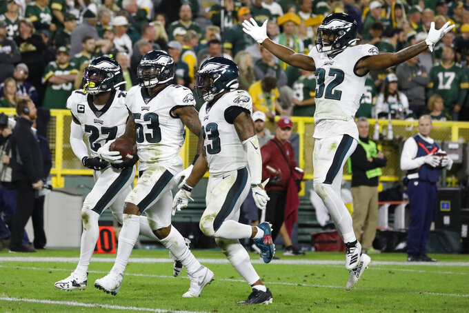 Philadelphia Eagles outside linebacker Nigel Bradham (53) and teammates celebrate his interception in the last minute of the team's NFL football game against the Green Bay Packers on Thursday, Sept. 26, 2019, in Green Bay, Wis. Philadelphia won 34-27. (AP Photo/Jeffrey Phelps)