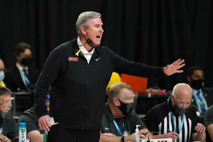 Western Kentucky head coach Rick Stansbury directs his team during the first half of the championship game against North Texas in the NCAA Conference USA men's basketball tournament Saturday, March 13, 2021, in Frisco, Texas. (AP Photo/Tony Gutierrez)