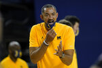 Michigan head coach Juwan Howard yells at a referee in the second half of an NCAA college basketball game againstToledo in Ann Arbor, Mich., Wednesday, Dec. 9, 2020. Howard was given a technical foul. (AP Photo/Paul Sancya)