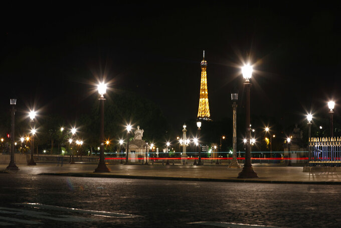 View of the Eiffel Tower from the deserted Concorde square during nationwide confinement measures to counter the Covid-19, in Paris, Friday, May 8, 2020. France continues to be under an extended stay-at-home order until May 11 in an attempt to slow the spread of the COVID-19 pandemic. (AP Photo/Thibault Camus)