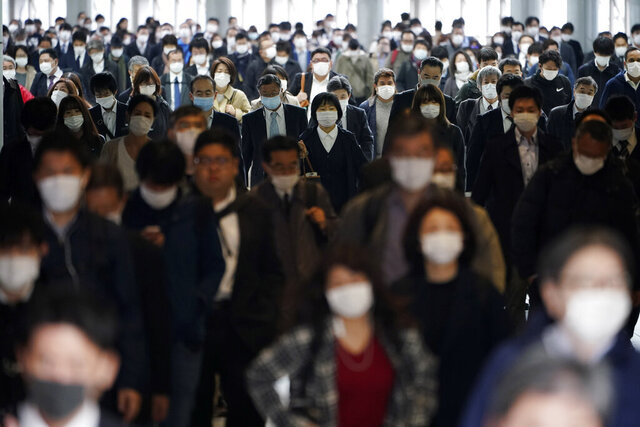 "FILE - In this April 27, 2020, file photo, a station passageway is crowded with commuters wearing face mask in Tokyo. Tokyo Olympic CEO Toshiro Muto talked Thursday, May 21, about the need to take ""countermeasures"" to combat COVID-19 at next year's postponed games. (AP Photo/Eugene Hoshiko, File)"