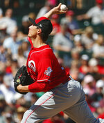 Cincinnati Reds pitcher Homer Bailey throws against the Los Angles Angels during the first inning of a spring training baseball game Monday, March 12, 2018, in Tempe, Ariz. (AP Photo/Matt York)