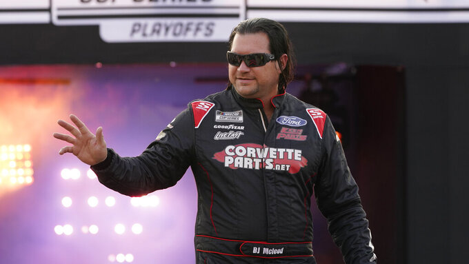 BJ McLeod waves to the crowd during driver introductions prior to the start of the NASCAR Cup series auto race in Richmond, Va., Saturday, Sept. 11, 2021. (AP Photo/Steve Helber)