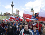 Critics of the European Union march through Warsaw to protest against what they call EU's dictate from Brussels, as Poland and other central European nations ceremoniously mark 15 years of membership in the club, in Warsaw, Poland, Wednesday, May 1, 2019. (AP Photo/Czarek Sokolowski)