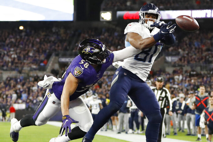 Baltimore Ravens linebacker L.J. Fort (58) breaks up a pass to Tennessee Titans tight end Jonnu Smith (81) during the second half of an NFL divisional playoff football game, Saturday, Jan. 11, 2020, in Baltimore. (AP Photo/Julio Cortez)