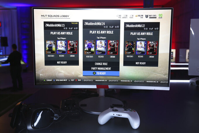 FILE - This Aug. 24, 2017, file photo shows screens of a video game at a Madden NFL 18 Launch Event in New York. The Madden franchise will continue to be a part of the gaming universe for at least the next six years. NFL owners on Thursday, May 28, 2020, approved an extension of their deal with Electronic Arts, continuing a relationship that has existed for 30 years. It was also recently approved by the NFL Players Association. (Mark Von Holden/AP Images for EA SPORTS Madden NFL 18, File)