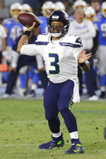 Seattle Seahawks quarterback Russell Wilson passes against the Los Angeles Chargers during the first half of an NFL preseason football game Saturday, Aug. 24, 2019, in Carson, Calif. (AP Photo/Alex Gallardo)