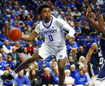 Kentucky's Ashton Hagans (0) looks for a teammate near Mount St. Mary's Nana Opoku during the second half of an NCAA college basketball game in Lexington, Ky., Friday, Nov. 22, 2019. Kentucky won 82-62. (AP Photo/James Crisp)