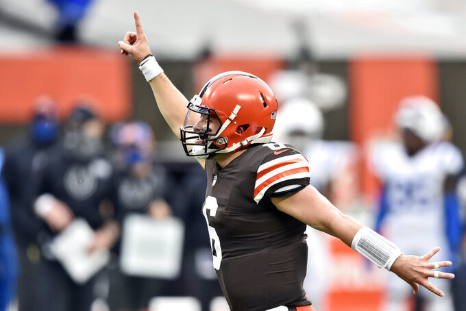 Cleveland Browns quarterback Baker Mayfield celebrates a 15-yard touchdown pass to wide receiver Rashard Higgins during the first half of an NFL football game against the Indianapolis Colts, Sunday, Oct. 11, 2020, in Cleveland. (AP Photo/David Richard)