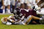Texas A&M linebacker Edgerrin Cooper (45) sacks Kent State quarterback Dustin Crum (7) during the fourth quarter of an NCAA college football game on Saturday, Sept. 4, 2021, in College Station, Texas. (AP Photo/Sam Craft)