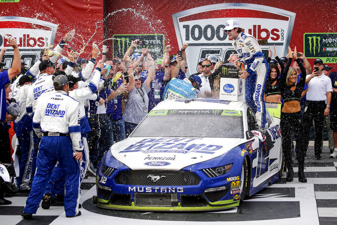 Monster Energy NASCAR Cup Series driver Ryan Blaney (12) celebrates in Victory Lane after wining the 1000Bulbs.com NASCAR Cup Series auto race at Talladega Superspeedway, Monday, Oct 14, 2019, in Talladega, Ala. (AP Photo/Butch Dill)