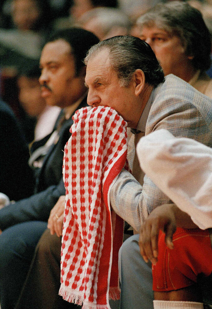 FILE - In this April 4, 1983, file photo, Guy Lewis, head coach of Houston, watches his team play North Carolina State in the NCAA championship game in Albuquerque, N.M. North Carolina defeating top-ranked Houston 54-52. (AP Photo/Fle)