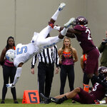 North Carolina Dazz Newsome (5) dives into the endzone past Virginia Tech defenders Chamarri Conner (22) and Caleb Farley (3) during the second quarter of an NCAA college football game Saturday, Oct. 19 2019, in Blacksburg Va. (Matt Gentry/The Roanoke Times via AP)