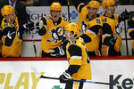Pittsburgh Penguins' Jared McCann (19) returns to the bench after scoring in a shootout during an NHL hockey game against the Chicago Blackhawks in Pittsburgh, Saturday, Nov. 9, 2019. (AP Photo/Gene J. Puskar)