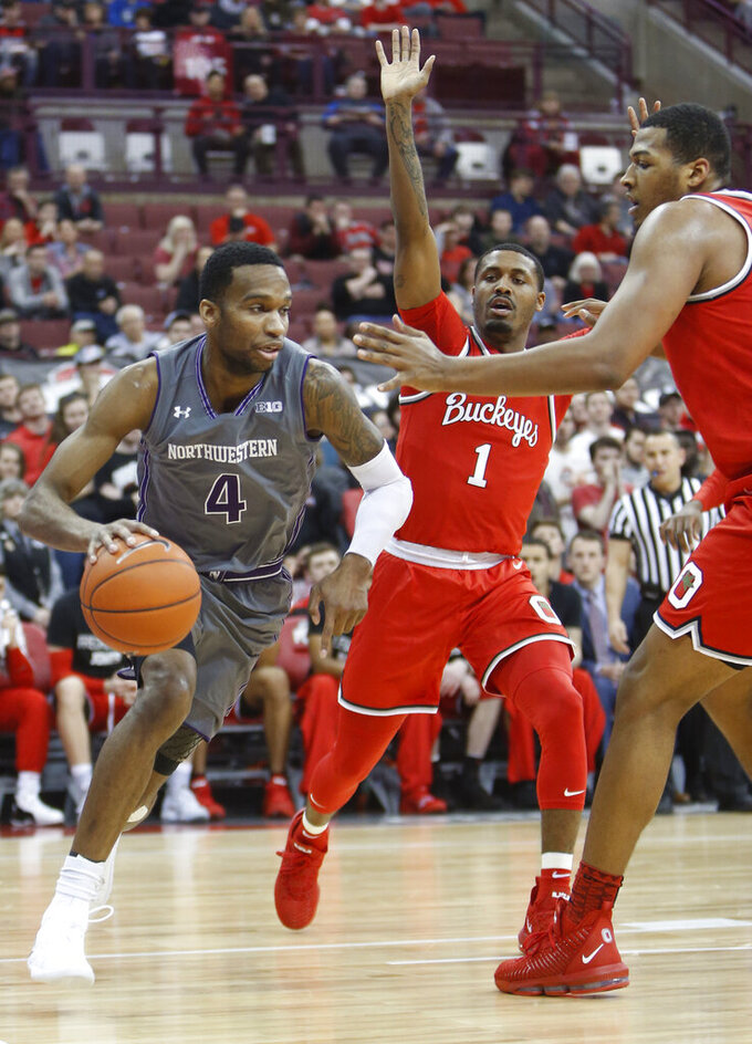 Northwestern's Vic Law, left, drives the baseline against Ohio State's Luther Muhammad, center, and Kaleb Wesson during the first half of an NCAA college basketball game Wednesday, Feb. 20, 2019, in Columbus, Ohio. (AP Photo/Jay LaPrete)