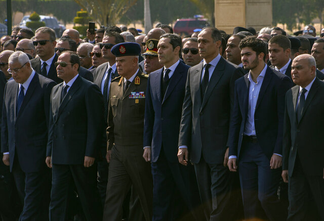 ADDS NAME OF GRANDSON OF THE FORMER PRESIDENT AS OMAR ALAA MUBARAK -- Dignitaries and family members attend the funeral of former President Hosni Mubarak, at Tantawi Mosque, in eastern Cairo, Egypt, Wednesday, Feb. 26, 2020. Egypt is holding a full-honors military funeral for Mubarak who was ousted from power in the 2011 Arab Spring uprising. The 91-year-old Mubarak died on Tuesday at a Cairo military hospital from heart and kidney complications. In front row from left, is former interim President Adly Mansour, current President Abdel Fattah el-Sissi, Military Chief of Staff Mohamed Farid Hegazy, sons of the former president Alaa and Gamal Mubarak, a grandson of the former president Omar Alaa Mubarak, and former Defense Minister Sedki Sobhi. (AP Photo/Hamada Elrasam)