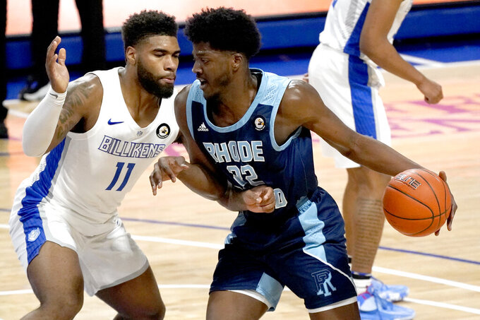 Rhode Island's Makhel Mitchell (22) heads to the basket as Saint Louis' Hasahn French (11) defends during the first half of an NCAA college basketball game Wednesday, Feb. 10, 2021, in St. Louis. (AP Photo/Jeff Roberson)