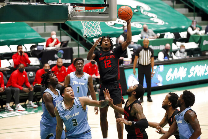 Houston guard Tramon Mark (12) shoots over Tulane forward Tylan Pope (3) during the second half of an NCAA college basketball game in New Orleans, Thursday, Jan. 28, 2021. Houston won 83-60. (AP Photo/Tyler Kaufman)