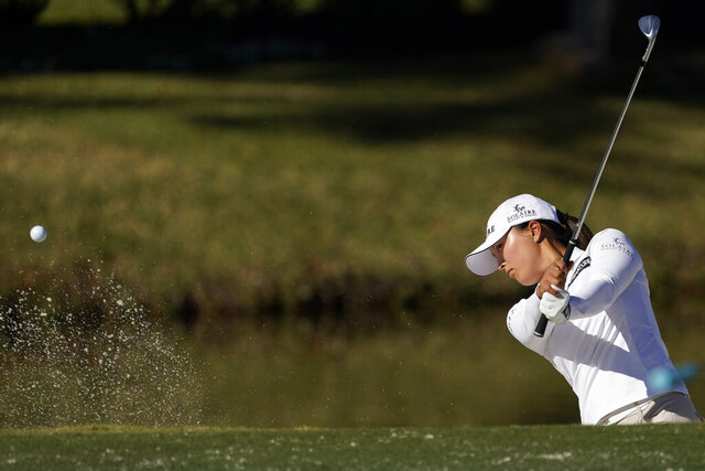 Jin Young Ko, of Korea, hits out of a bunker on the 11th hole during a practice round at the U.S. Women's Open golf championship Tuesday, Dec. 8, 2020, in Houston.(AP Photo/David J. Phillip)