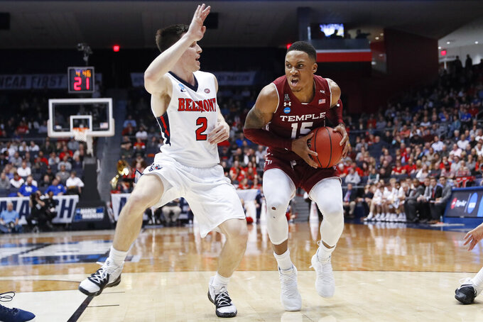Temple's Nate Pierre-Louis (15) drives against Belmont's Grayson Murphy (2) during the second half of a First Four game of the NCAA college basketball tournament, Tuesday, March 19, 2019, in Dayton, Ohio. (AP Photo/John Minchillo)