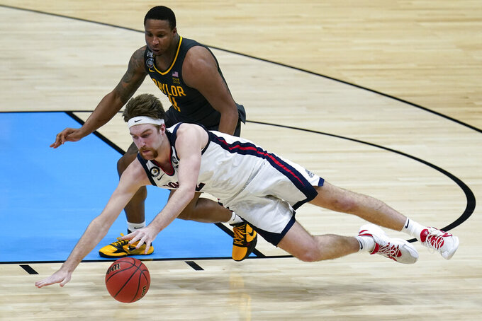 Gonzaga forward Drew Timme loses control of the ball ahead of Baylor guard Mark Vital, rear, during the second half of the championship game in the men's Final Four NCAA college basketball tournament, Monday, April 5, 2021, at Lucas Oil Stadium in Indianapolis. (AP Photo/Michael Conroy)