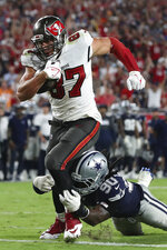 Tampa Bay Buccaneers tight end Rob Gronkowski (87) beats Dallas Cowboys defensive end DeMarcus Lawrence (90) to the endzone to score on an 11-yard touchdown reception during the second half of an NFL football game Thursday, Sept. 9, 2021, in Tampa, Fla. (AP Photo/Mark LoMoglio)