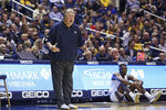 West Virginia coach Bob Huggins reacts to a call during the second half of an NCAA college basketball game against Nicholls State Saturday, Dec. 14, 2019, in Morgantown, W.Va. (AP Photo/Kathleen Batten)