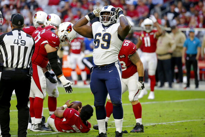 Los Angeles Rams defensive tackle Sebastian Joseph-Day (69) celebrates his sack of Arizona Cardinals quarterback Kyler Murray (1) during the second half of an NFL football game, Sunday, Dec. 1, 2019, in Glendale, Ariz. (AP Photo/Rick Scuteri)