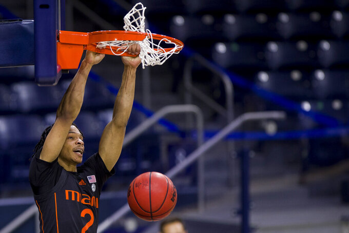 Miami's Isaiah Wong (2) dunks during the second half of an NCAA college basketball game against Notre Dame on Sunday, Feb. 14, 2021, in South Bend, Ind. Notre Dame won 71-61. (AP Photo/Robert Franklin)