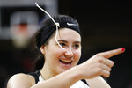 Iowa forward Megan Gustafson celebrates after the team's game against Missouri in the second round of the NCAA women's college basketball tournament Sunday, March 24, 2019, in Iowa City, Iowa. Iowa won 68-52. (AP Photo/Charlie Neibergall)
