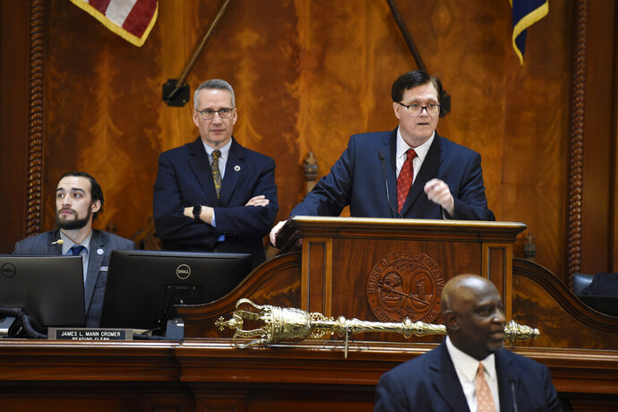 South Carolina House Speaker Jay Lucas, right, and Speaker Pro Tem Tommy Pope, left, stand at the well during the 2020 legislative session on Tuesday, Jan. 14, 2020, in Columbia, S.C. (AP Photo/Meg Kinnard)