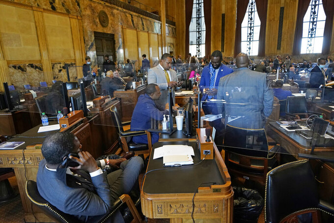 Ted James, D-Baton Rouge, second right, charmain of the Legislative Black Caucus in Baton Rouge, talks with fellow caucus members during opening day of the Louisiana legislative session in Baton Rouge, La., Monday, April 12, 2021. (AP Photo/Gerald Herbert)